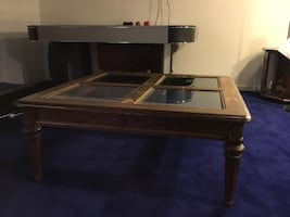 Square brown wooden center table with four glass panel