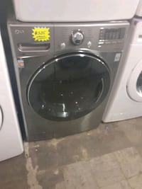 LG front load washer working perfectly with 4 months warranty  Baltimore, 21223