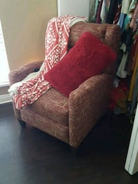 brown and red floral fabric sofa chair