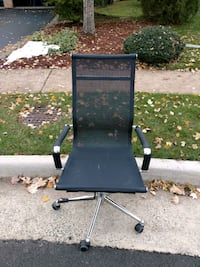 black and brown metal framed rolling armchair 7 km