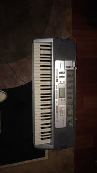 Casio LH -110. Slightly used. Includes piano stand. Local delivery is free, shipping is $30 in the U.S. Manassas, 20112
