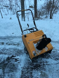 Yellow and black snow blower