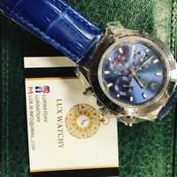 round silver chronograph watch with blue leather strap Brossard, J4W 2Y9