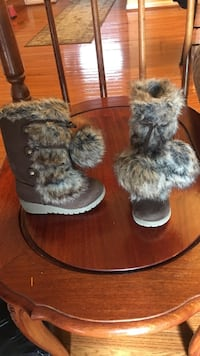 pair of brown and gray fur sheepskin boots