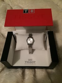TISSOT Round silver analog watch with link bracelet in box