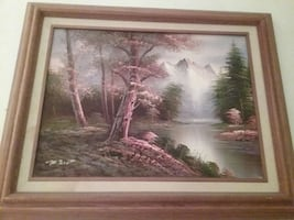 Brown wooden framed tree near river painting