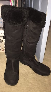 pair of black suede knee-high boots
