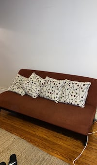 Love seat/couch with pillows