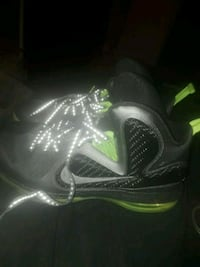 pair of black-and-green Nike basketball shoes Tallahassee, 32310