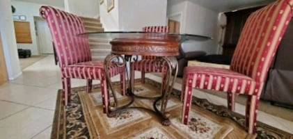 Round GlassTable with 4 chairs also have covers for all 4