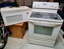 White Whirlpool Electric Range Oven and Maytag Microwave