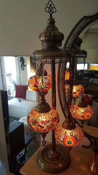 brass frame with red stained glass table lamp