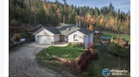 Private acreage with large home backing hundreds if acres of forest