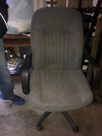 Office Chair on wheels handle to raise or lower and lever to hold still or be able to lean back. Cloth material in good condition. Johnstown, 43031