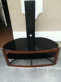 brown wooden framed glass top TV stand West Palm Beach, 33406