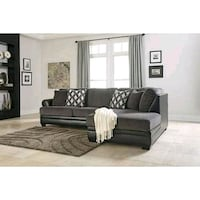 A black and grey sectional  Omaha, 68105