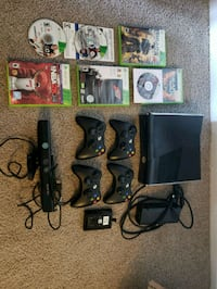 black Xbox 360 with controllers and game cases 25 mi