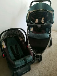 baby's black and green travel system Alhambra, 91801