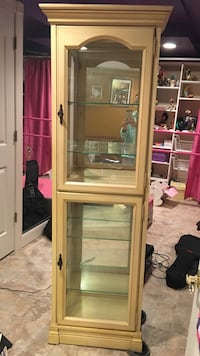 Cream colored curio cabinet.  Great condition.  Lights up! 6 shelves Manalapan, 07726