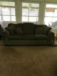 Massoud sofa. Green fabric 3 seat sofa. All four corners scratched by cat!  Chattanooga, 37421