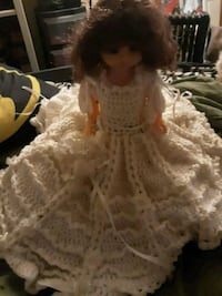 brown and white dressed doll