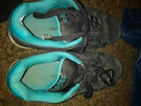 pair of black and teal bulky shoes
