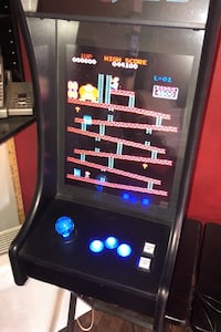 Arcade machine with all the games old and young will love frogger