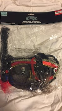 black, red, and white Alterego pirate mask with ribbon plastic pack