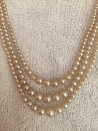 gold-colored beaded necklace Sarasota, 34233