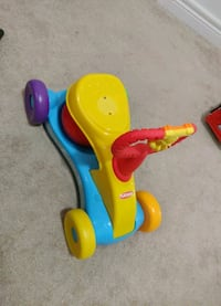 toddler's blue and yellow ride on toy Brampton, L7A 0G1