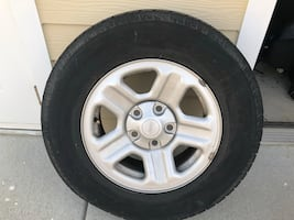 Gray jeep 5-spoke wheel with tire