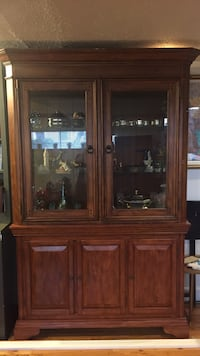 brown wooden china cabinet Laval, H7X 3L5