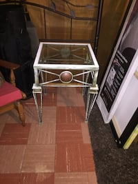 white metal framed glass top table