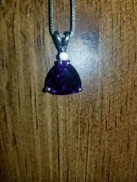 silver and purple gemstone pendant