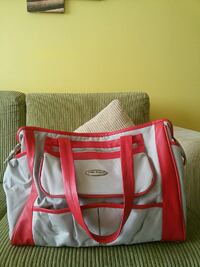 red and gray leather hand bag