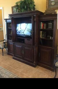 black flat screen TV with brown wooden TV hutch Centerville