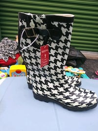 Size 7 women's boots new tags on them Tampa, 33625