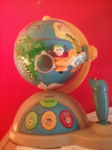 toddler's multicolored V-Tech activity toy