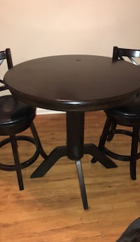round brown wooden table with two chairs Nashville, 37076