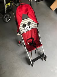 baby's red Mickey Mouse umbrella stroller