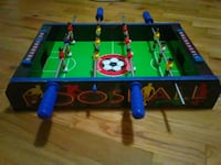 blue green and red foosball table