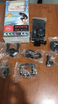 black HD action camera with accessories Longueuil, J4T 3T2