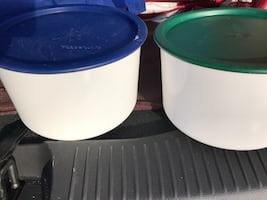 Two green and blue plastic food containers