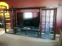flat screen television with brown wooden TV hutch Aurora, 80011
