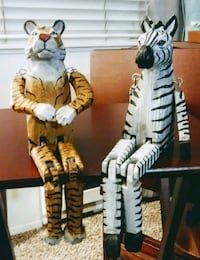 two tiger and zebra figurines