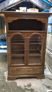 brown wooden framed glass display cabinet Puyallup, 98374