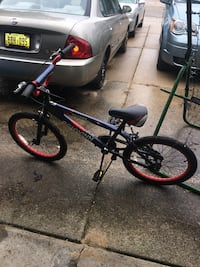 Red and blue Schwinn boys bike 16in Wyoming, 49418