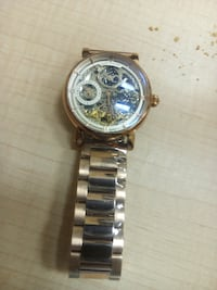 round gold chronograph watch with link bracelet Toronto