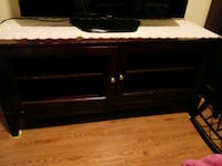 Dark brown tv stand-no glass drs. Used Houston, 77042