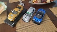 three blue, white, and brown sports car scale models Whitchurch-Stouffville, L4A 0R4